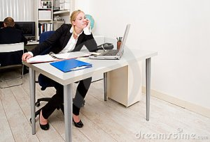 Bored woman at desk in office