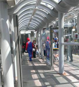 Man dressed in Super Mario costume on train platform